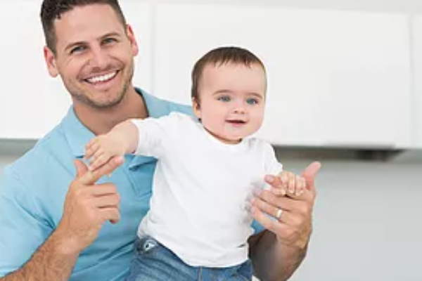 Miracle Surrogacy Father and Baby